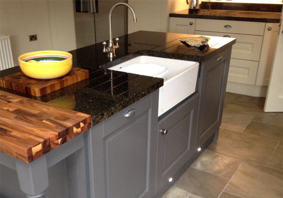Jefferson painted mussel and lava kitchen with granite worktop and upstands.